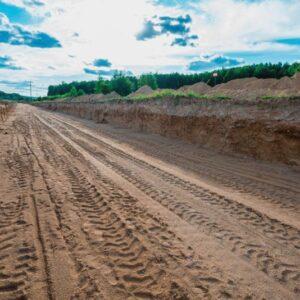 Планировка грунта в дорожном корыте подпроектную отметку